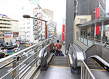 Go down to the ground level by the escalator and then head straight to Keio-hachioji Station.
