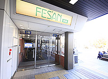 Go outside through the automatic doors to your right. Then head left to find the entrance to the south building of Fesan and descend to the B1 floor.