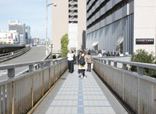 Head down the footbridge, go down the stairs in front of Kaisei Hospital