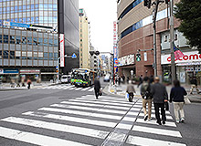 Cross the main street, and go between NTT Docomo and SMBC Nikko Securities.